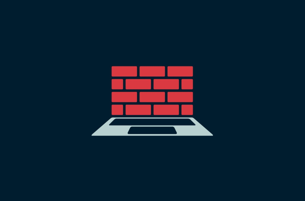Laptop with a brick wall.