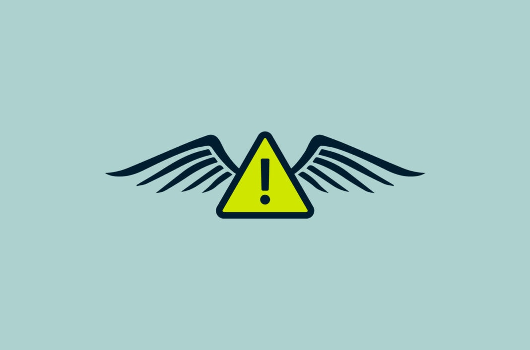 An alert symbol with wings.