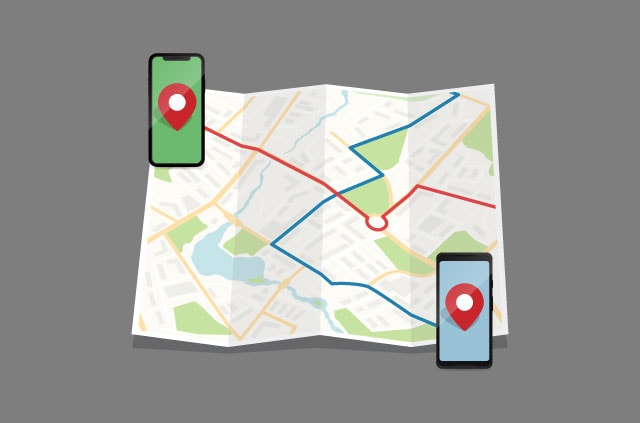 Two phones on a map with lines intersecting from them.