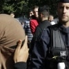 Police officer and woman wearing niqab - national security