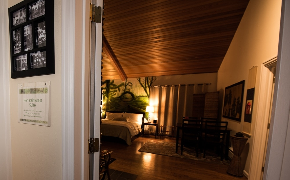 Looking into the HoH Rainforest Suite at Domaine Madeleine from the shared space in the main house.