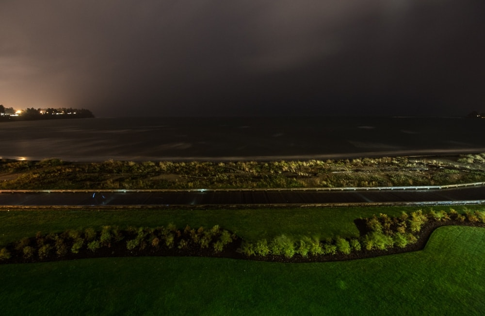 View of the storm as night from our ocean-view room balcony at The Beach Club Resort in Parksville