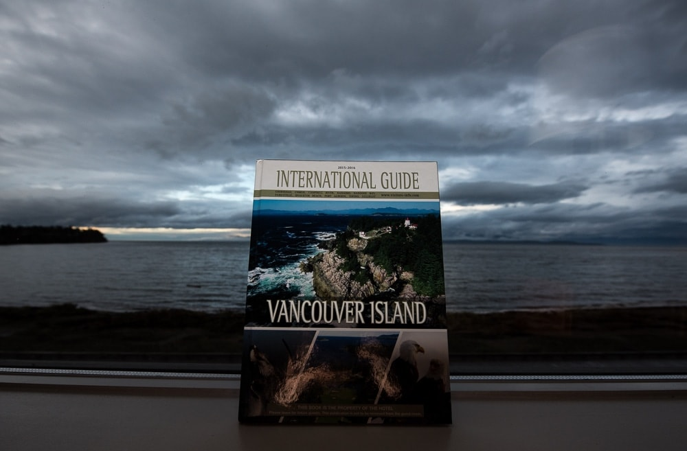 Vancouver Island guide book set against the window of the view from our room at the beach club resort parksville bc