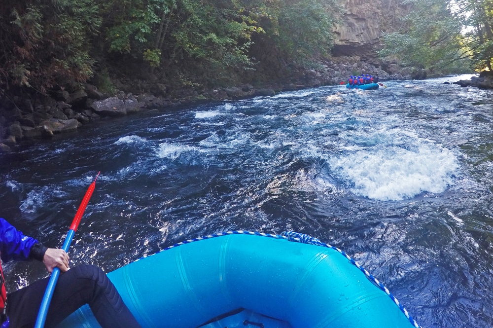 Taking a break and enjoying the views during our whitewater rafting trip down the White Salmon River