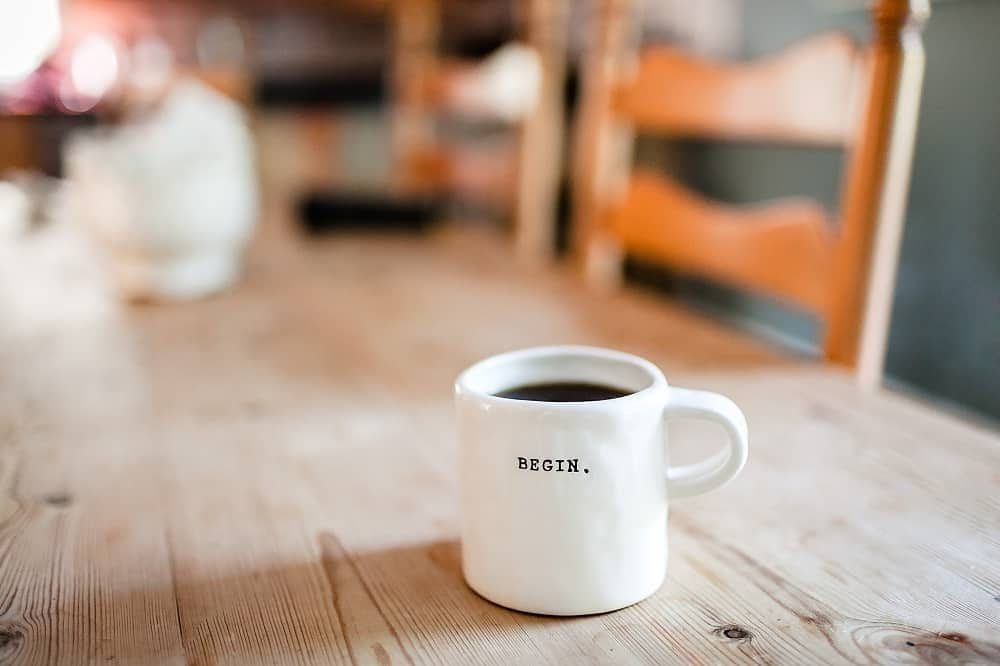 mug with the word begin printed on it