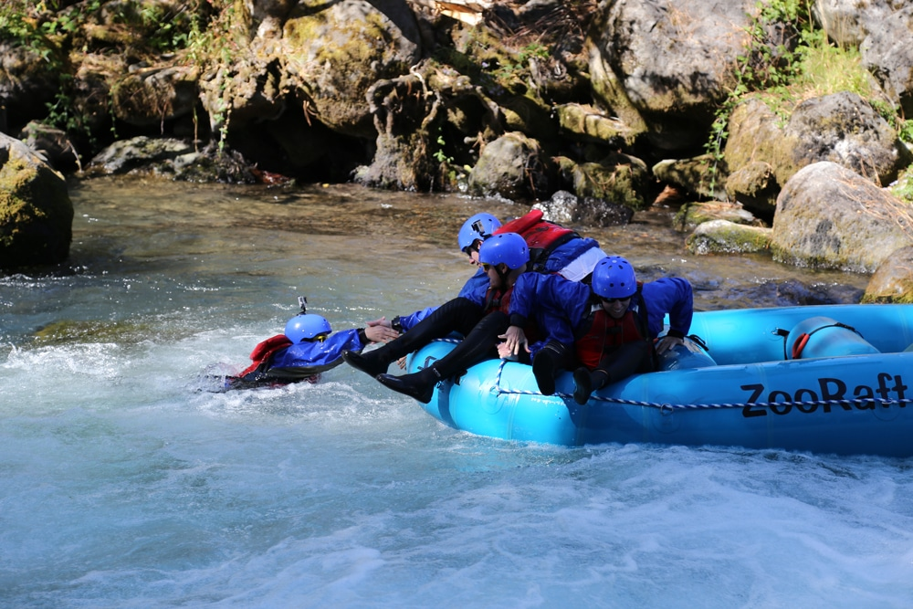 Helping pull Brooke back into the raft after she fell out 'Riding the Bull' on the White Salmon River.