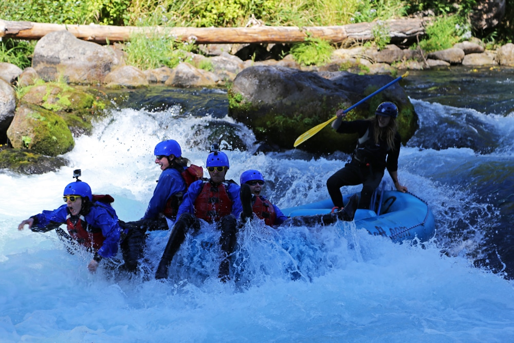 Brooke looks like she is jumping out of the raft while 'Riding the Bull' on the White Salmon River.