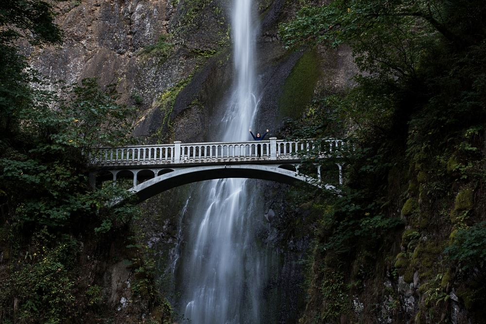 Brooke standing atop Benson Bridge at Multnomah Falls in Oregon