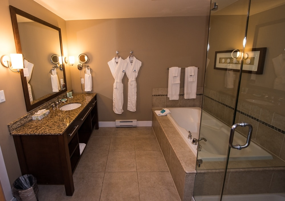 Large bathroom, with soaking tub, walk-in shower and complimentary robes to use