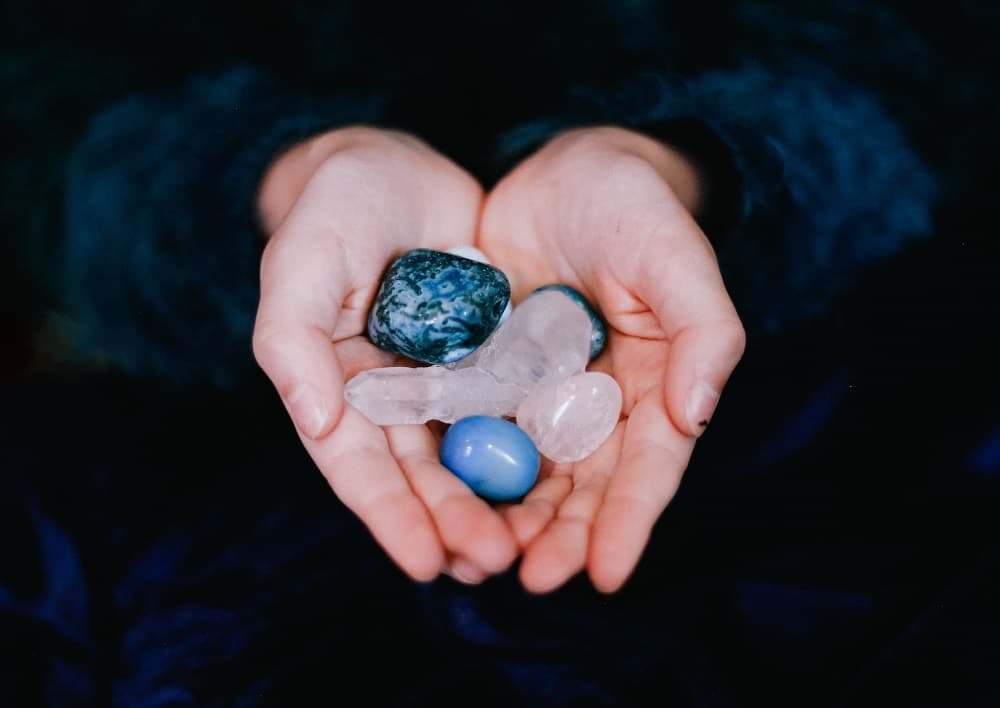 person holding crystals in hands