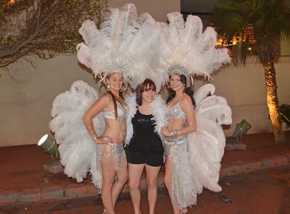 Brooke posing for a photo with some of the Las Vegas Dancers and streel performers