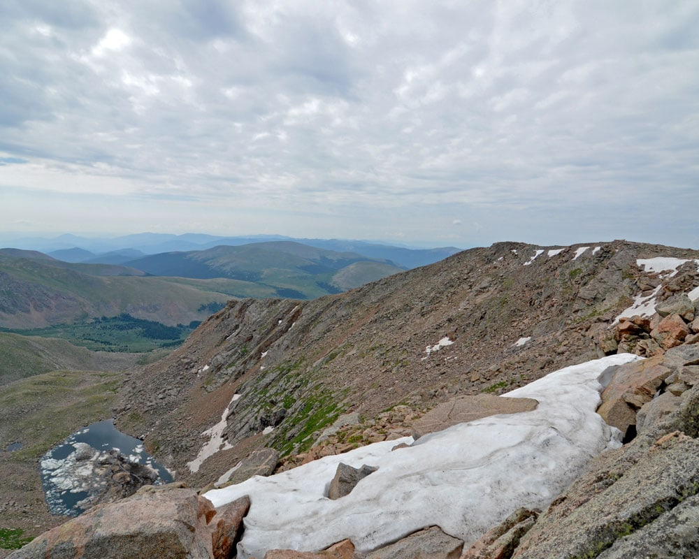 Snow on the mountain side during the hike to Mt. Bierstadt in summer.