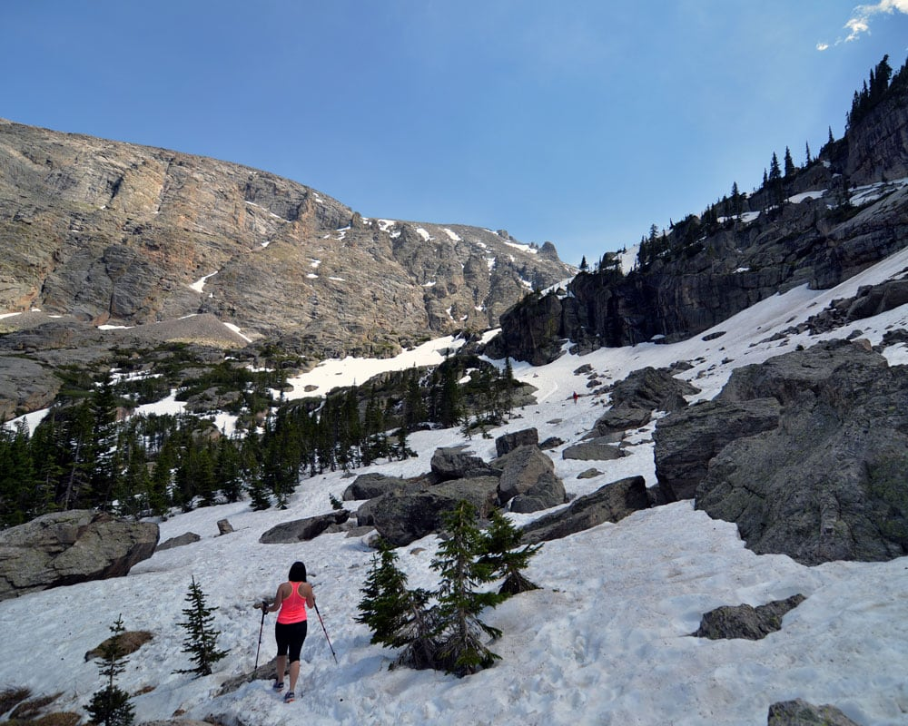 Brooke hiking through the snowfields on the way to Timberline Falls.