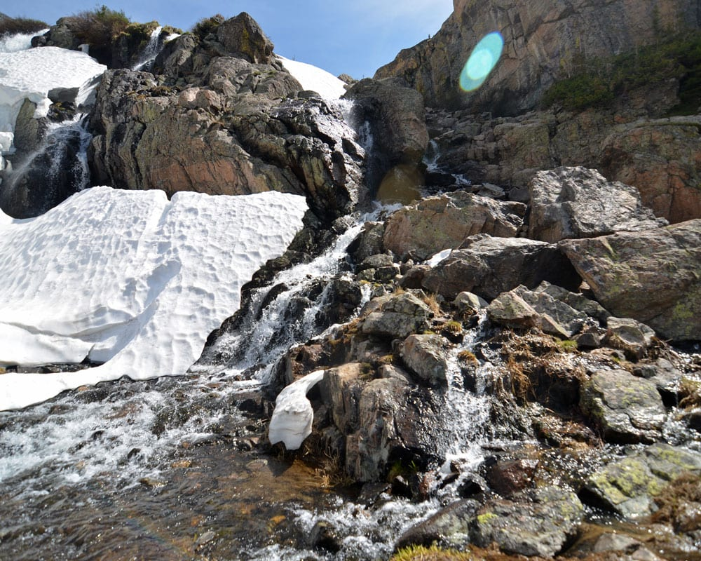 Timberline Falls surrounded by snow and ice.