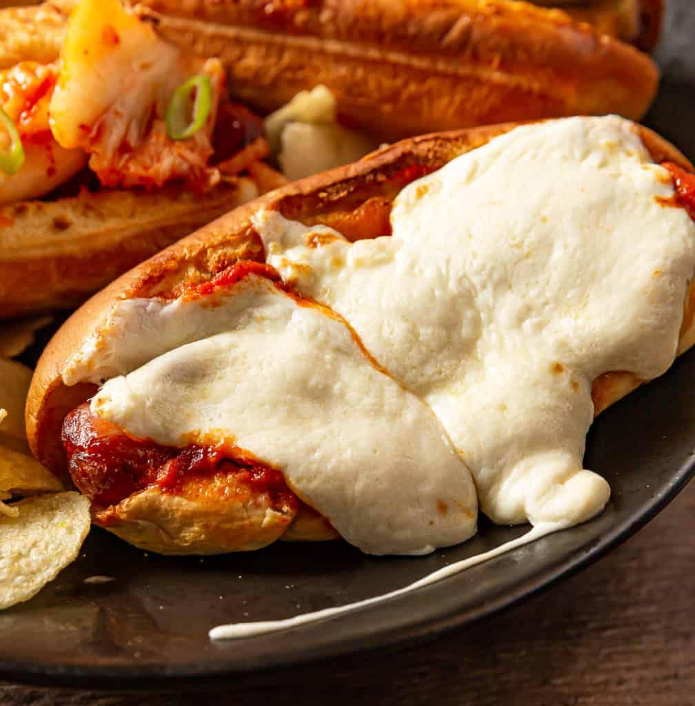 hot dog with mozzarella and marinara sauce