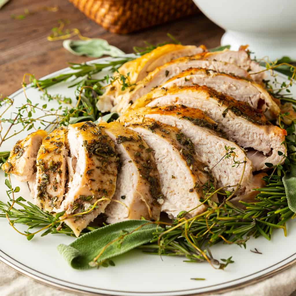 Sliced bone in roasted turkey breast