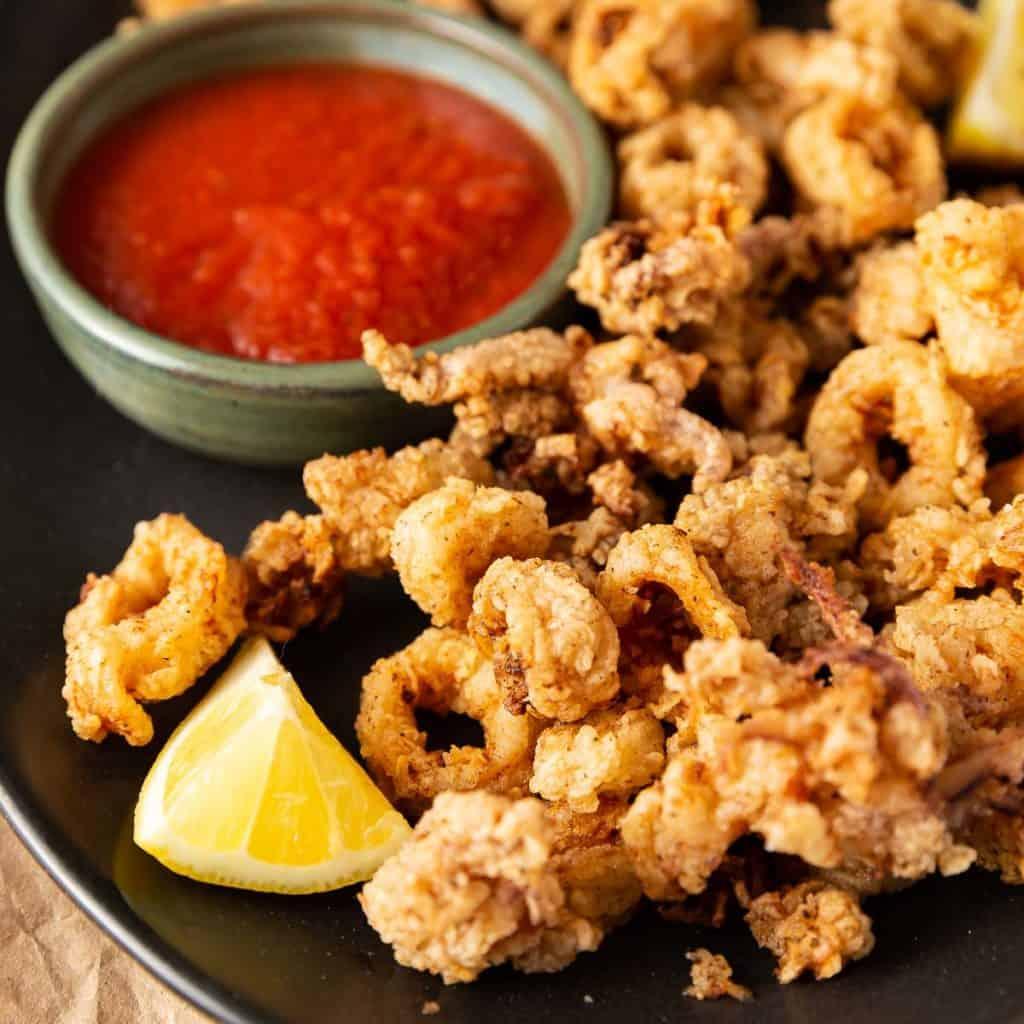 fried calamari with lemon and dipping sauce