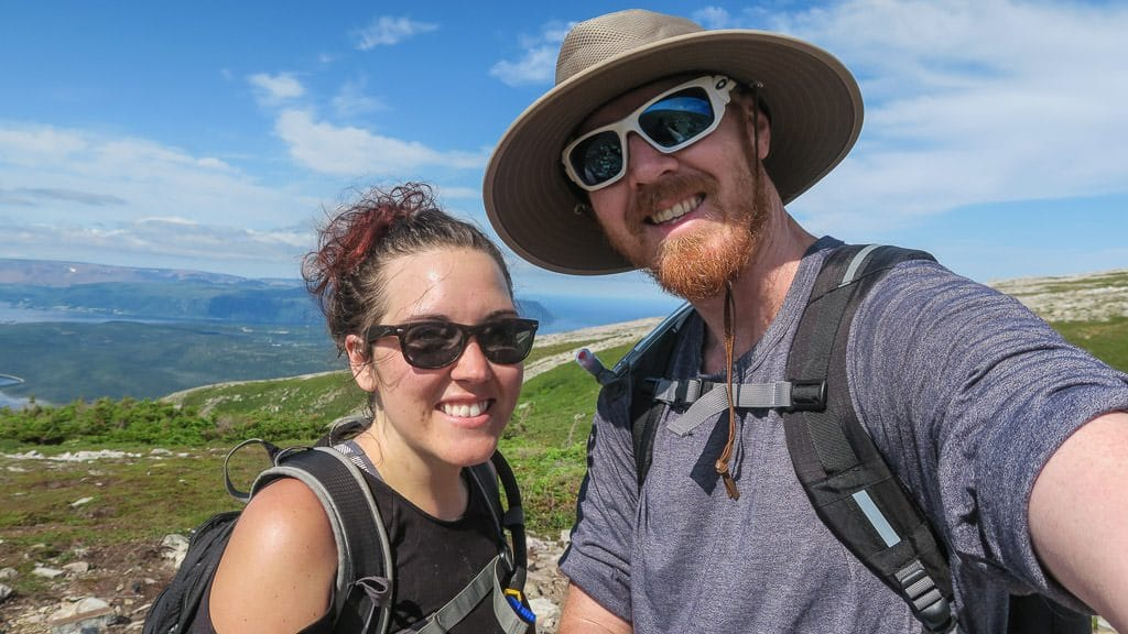 Brooke and Buddy taking a photo after reaching the top of the rock gully
