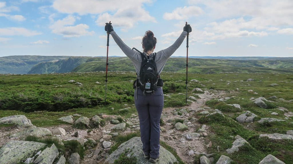 Brooke raising her arms at the top of Gros Morne Mountain