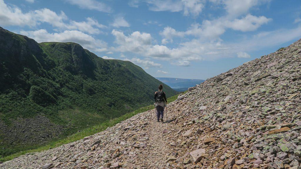 Brooke hiking down the rocky trail