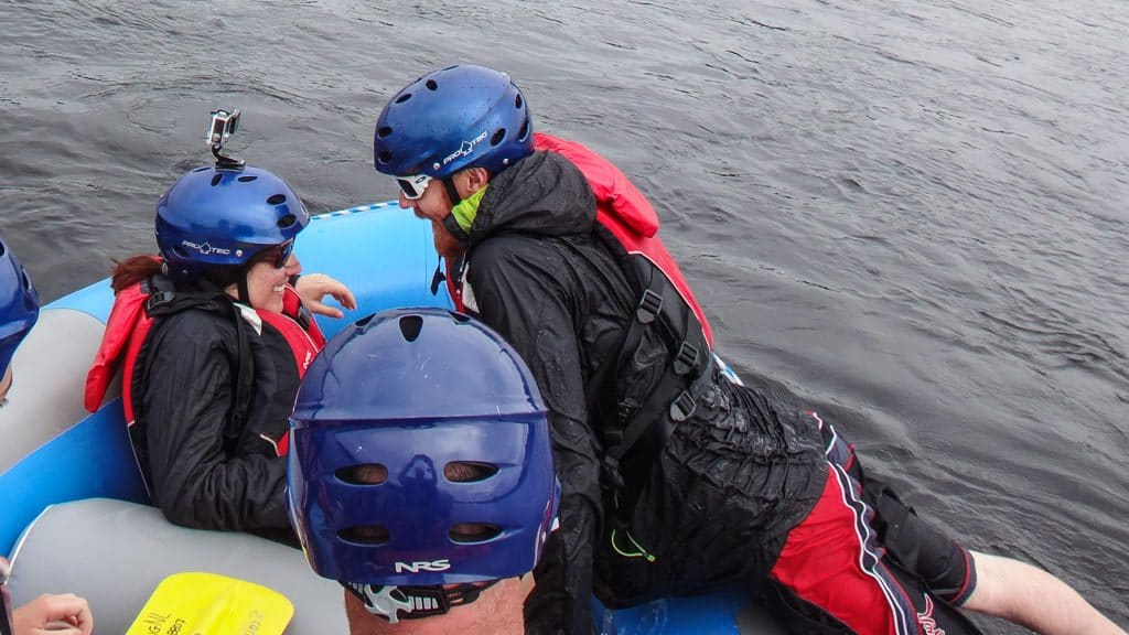 Brooke pulling Buddy back into the raft after he 'fell' into the Exploits River