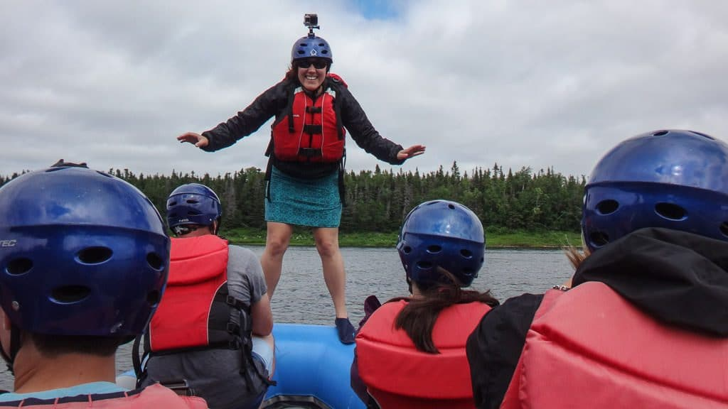 Brooke standing on the edge of the raft during the balance game