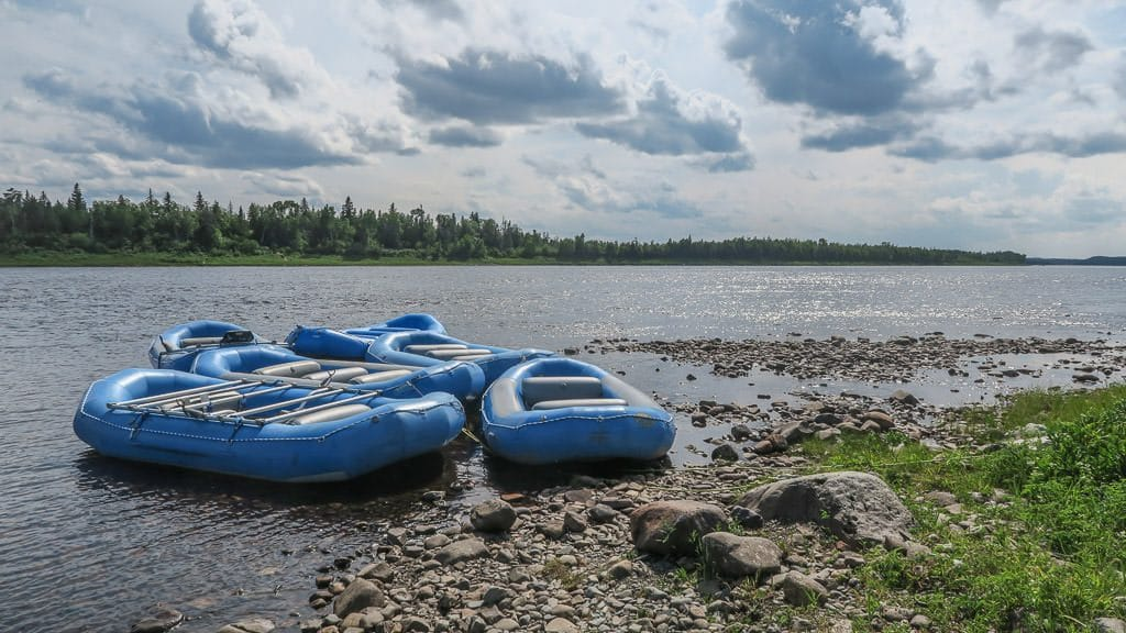White water rafting rafts sitting on the edge of the Exploits River