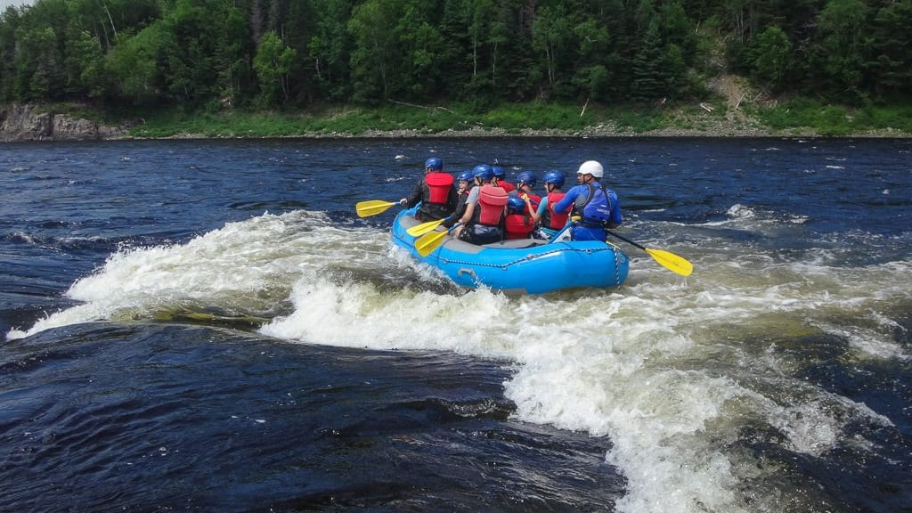Surfing the waves of the Exploits River with ONadventure Wilderness Tours