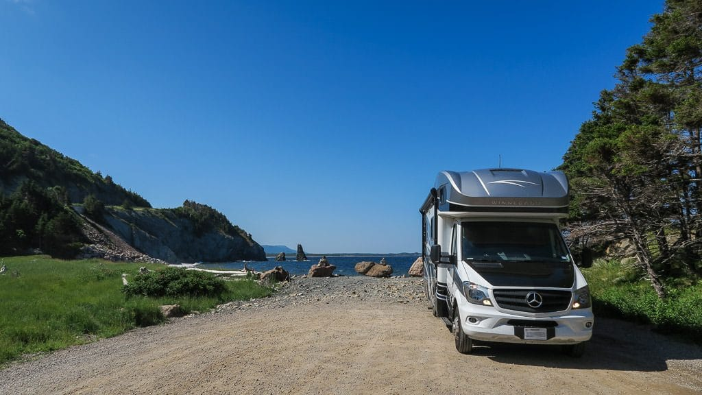 Our Winnebago View parked next to the ocean along the Cabot Trail