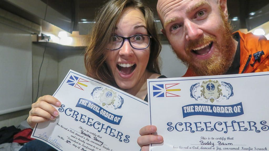 Brooke and Buddy holding their certificates showing they were officially screeched in, which is the top thing to do in Gros Morne National Park, or Newfoundland in general