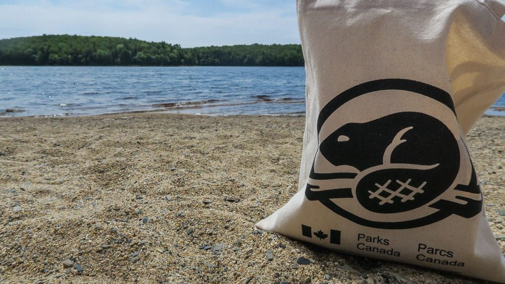 Parks Canada reusable bag on the beach in kejimkujik national park