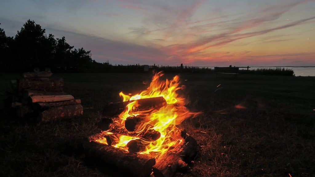 Campfire at our RV site in Cabot Beach Campground during sunset