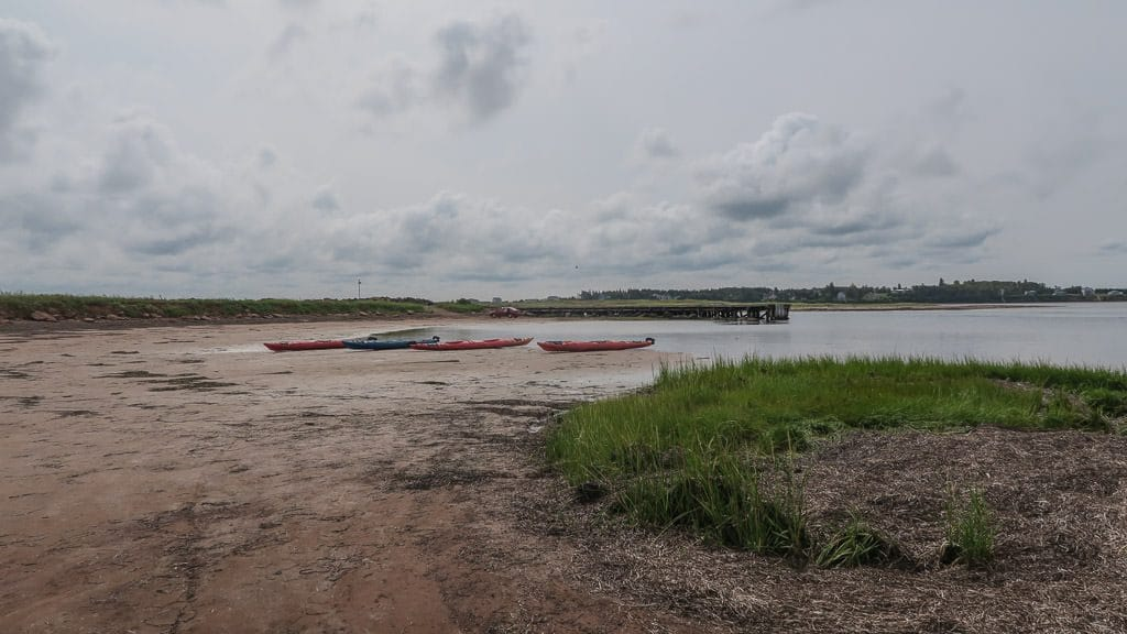 Kayaks on the sand during low tide before we set out kayaking in North Rustico