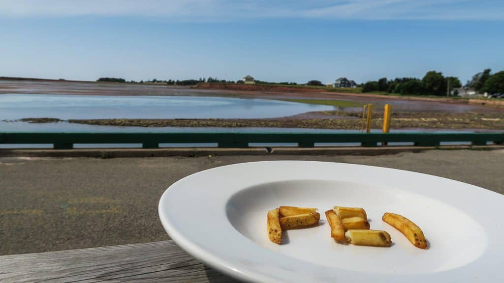 Prince Edward Island's famous french fries spelling out PEI on a plate