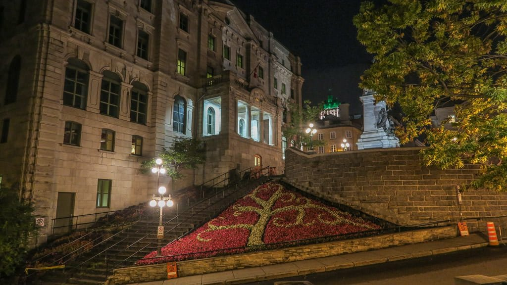 Beautiful designed garden area bext to historic building and stairs in Quebec City