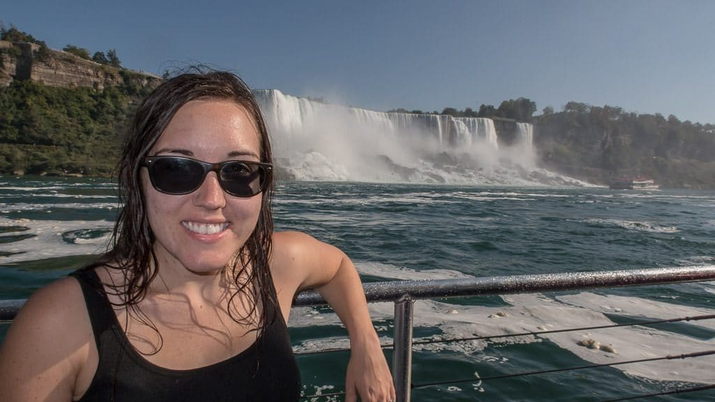Brooke soaking wet posing on our Hornblower Niagara Cruise boat with Niagara Falls in the background