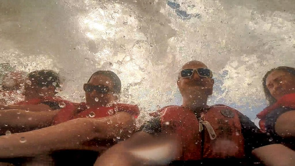 Huge wave of water crashing over us and the boat on our whirlpool jet boat tour