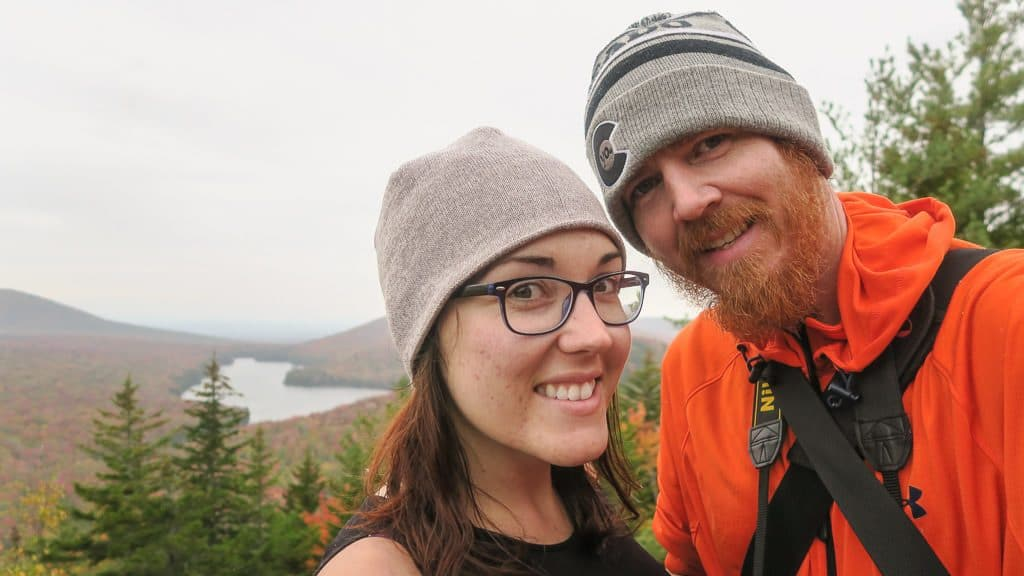 Brooke and Buddy taking a photo at the top of Owl's Head Overlook