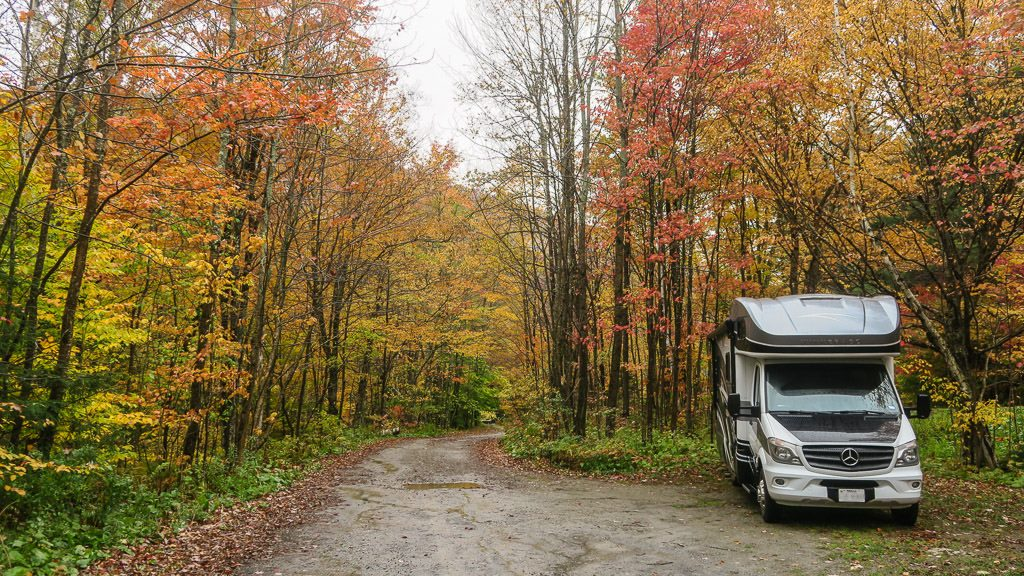 Our Winnebago View sitting off the dirt road on a nice colorful drive through Green Mountains while chasing fall in vermont