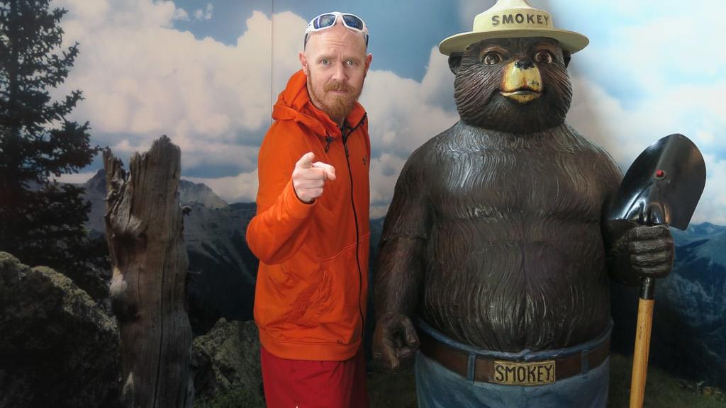 Buddy next to a large Smokey Bear statue at Smokey Bear Historical Park