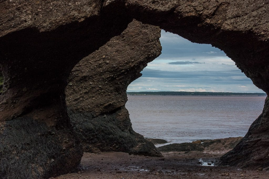 Looking through some of the arches in Hopewell Rocks during low tide