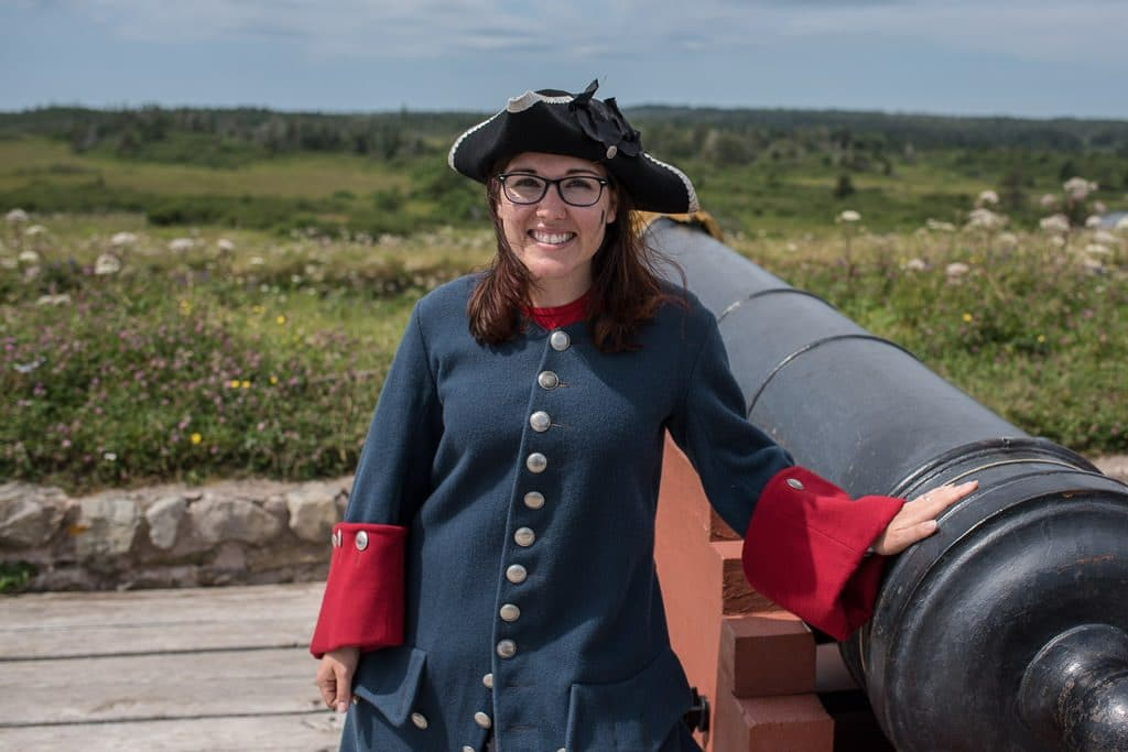 Brooke in her cannon firing outfit posing next to the cannon she had just fired