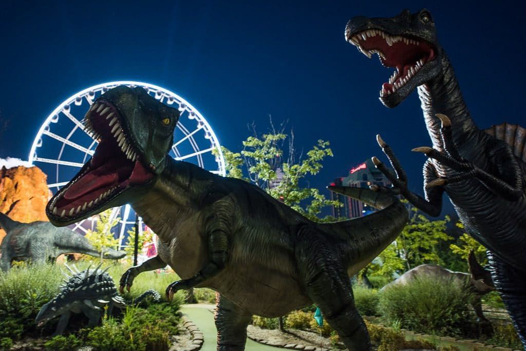 Dinosaurs at the putt-putt corse at Niagara Falls with the skywheel in the background