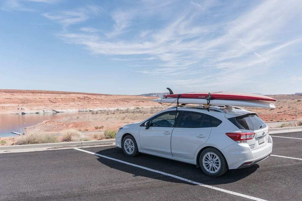Our Subaru with the rented paddleboards strapped to the top in prep for our trip Paddleboarding on Lake Powell