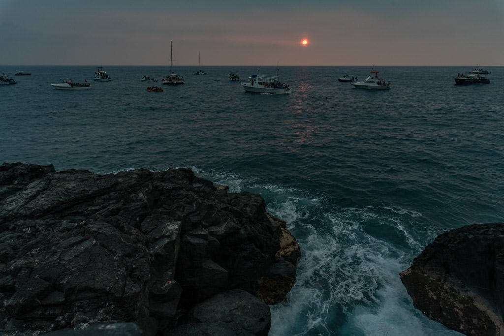 Sun setting through all the VOG in Kona from Ray's on the Bay