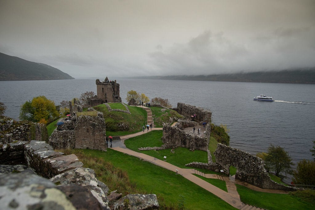 Urquhart Castle with loch ness in the background on a cloudy day in inverness