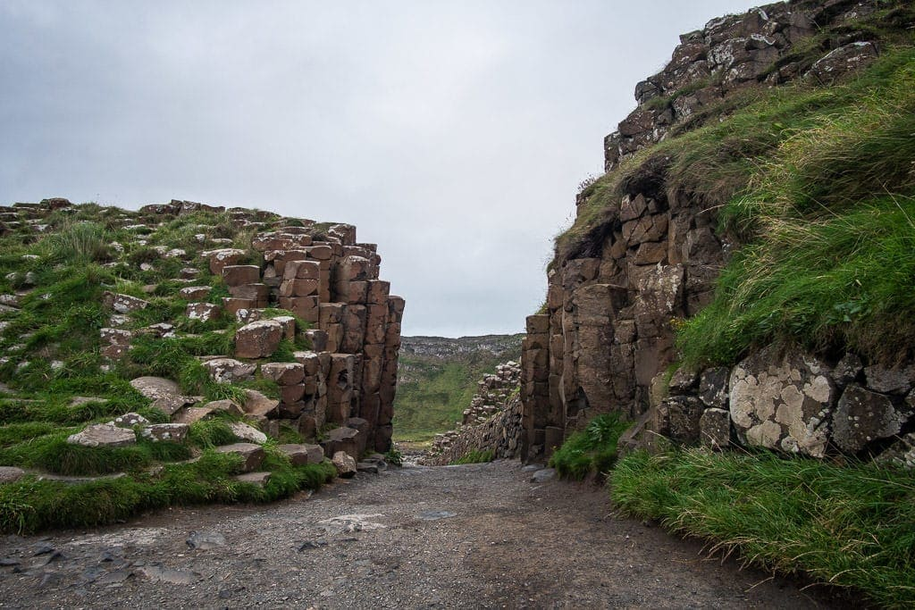 A path between the pillars of the volcanic rock formations at Giant's Causeway