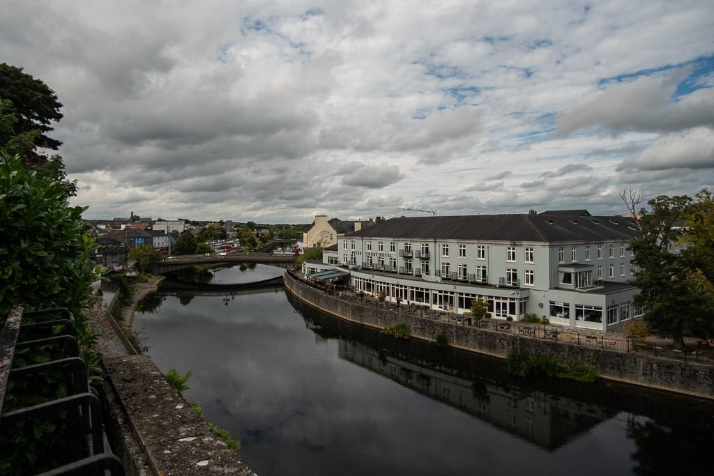 Reflections of a large building on the river in Kilkenny