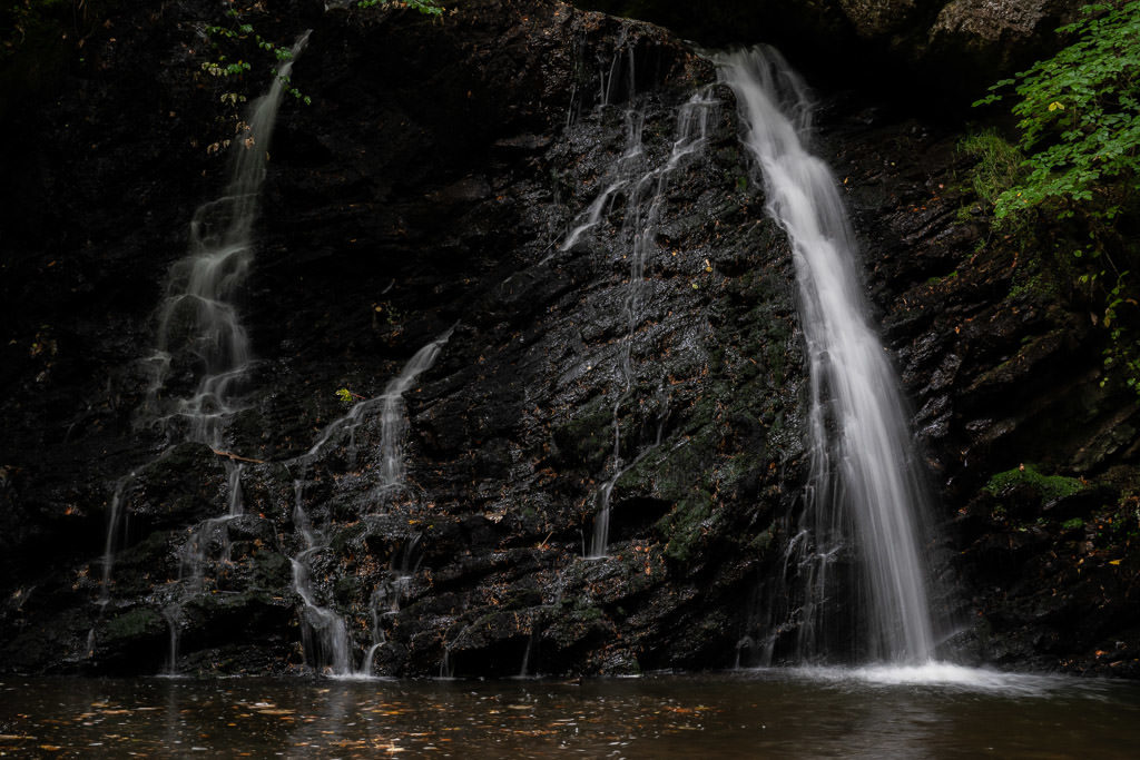 The first waterfall you get to at Fairy Glen Falls, which is multi-tiered and flowing over black rocks