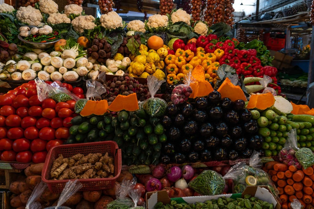 colorful fresh veggies in medina of tangier on day trip to Morocco tour